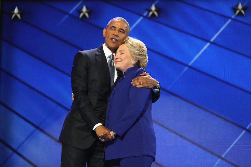 PHILADELPHIA, PA - JULY 27:  US President Barack Obama and Democratic presidential candidate Hillary Clinton embrace on the third day of the Democratic National Convention at the Wells Fargo Center, July 27, 2016 in Philadelphia, Pennsylvania. Democratic presidential candidate Hillary Clinton received the number of votes needed to secure the party's nomination. An estimated 50,000 people are expected in Philadelphia, including hundreds of protesters and members of the media. The four-day Democratic National Convention kicked off July 25.  (Photo by Joe Raedle/Getty Images)