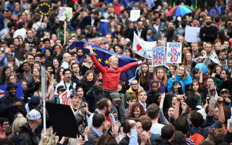 LONDON, ENGLAND - JUNE 28:  Protesters hold up signs and flags as they demonstrate against the EU referendum result outside the Houses of Parliament on June 28, 2016 in London, England. Up to 50,000 people were expected before the event was cancelled due to safety concerns. In the early evening a crowd still convereged on the square to vent their anti-Brexit feelings, before the protest moved to the Houses of Parliament.  (Photo by Jeff J Mitchell/Getty Images)